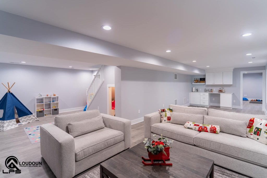 This renovated basement includes a family room, full bathroom, playroom, gym, wet-bar and under-stair storage.